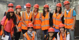 Summer school coach Katherine Foster (standing, fifth from left) and some of the students on a site visit.
