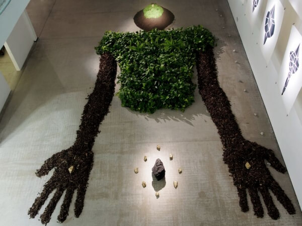 The Green Man - A Man made from plants that purifies air polluted by real people.